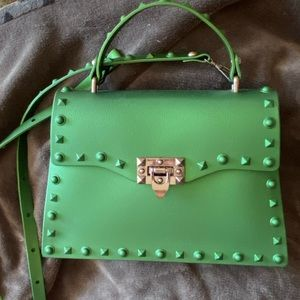 Green jelly pvc purse with same color stud detail